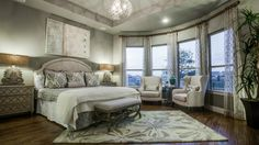 Treat yourself to a relaxing evening in your quiet #master #bedroom #suite tucked away in the back of your #luxuryhome and curl up with your favorite #book in your cozy #reading #nook. #interior #bedroomdecor #ideas