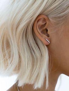 Chin length bob. | Slight bend added. | Tucked behind ears. | Platinum