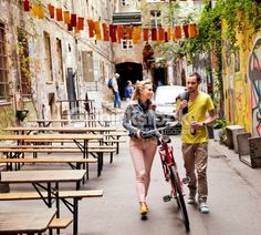 Stock Photo : Young Couple Walking in Alley