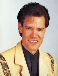 """Randy Travis (born May 4, 1959) is an American country music singer and actor. Since 1985, he has recorded 20 studio albums and charted more than 50 singles on the Billboard Hot Country Songs charts, and 16 of these were number one hits.Some hits are..""""Diggin' Up Bones"""". """"On the Other Hand""""  Always & Forever ,""""Heroes & Friends"""" """"Three Wooden Crosses"""" and more"""