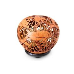 NOVICA Hand Carved Coconut Shell Sculpture with Stand ($65) ❤ liked on Polyvore featuring home, home decor, art gallery, brown, sculpture, wood - asian culture, ocean home decor, novica home decor, sea home decor y novica
