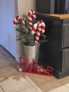 Cute Christmas decoration - Giant candy canes in metal vase.