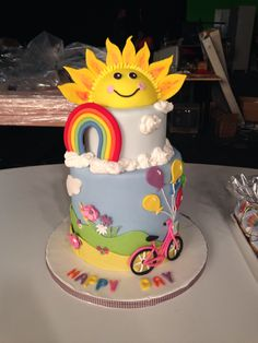 Happy Cake with sun, bicycle, clouds elements! Made at cookery school www.mathimatamageirikis.gr