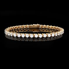 Cartier tennis bracelet - would be nice for the 20th anniversary. :)
