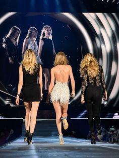 Martha Hunt, Taylor Swift, and Gigi Hadid strut their stuff on stage in Detroit, MI