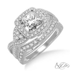 THIS EXQUISITE BRIDAL SET IS CRAFTED IN 14KT WHITE GOLD. THE ENGAGEMENT RING FEATURES A .40CT PRONG SET PRINCESS CUT DIAMOND FRAMED WITH PAVE SET ROUND DIAMONDS THAT FLOW & INTERTWINE THROUGHOUT. THE MATCHING BAND FEATURES ROUND CUT DIAMONDS PAVE SET. A HIGHTENED ARCH ON THIS ENGAGEMENT RING ALLOW A SPECTACULAR VIEW OF THE DETAILED ENGRAVING, MILLGARIN BEADING, & ACCENT DIAMONDS. TOTAL WEIGHT ON THIS PIECE IS 1CTW. 185-00431