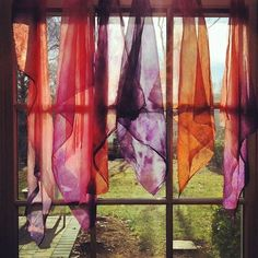 Scarves in the window.
