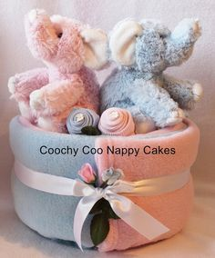 3 tier baby nappy cake with clothes to look like flowerscelebration new baby gift for twins nappy cake gift boy by coochycoonappycakes 4200 negle Choice Image
