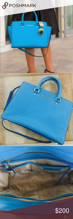 """• Michael Kors Selma Topzip in Large • In excellent used condition. Some markings on the bottom inner liner. Also some scratches on the little legs where you sit it down. Can be worn as a cross body or held by the two straps. Measures 13"""" by 10"""" width of the bottom is 5"""". 100% Authentic. Color is Aqua Blue. My price is firm. Please no offers. Michael Kors Bags Totes"""
