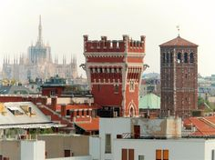 Milan (Italy) - Duomo, tower of the Cova Castle and main bell tower of the Basilica of Sant'Ambrogio