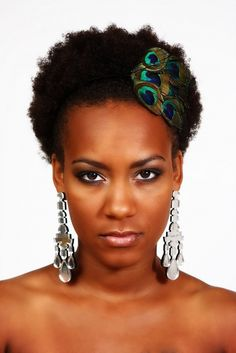 natural hair w/peacock feathered adornment...cute!