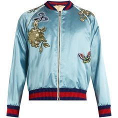 Gucci's sky-blue silk-satin bomber jacket is embroidered with an ornate pattern of tropical birds and butterflies a vibrant ode to the label's SS17 theme of t…