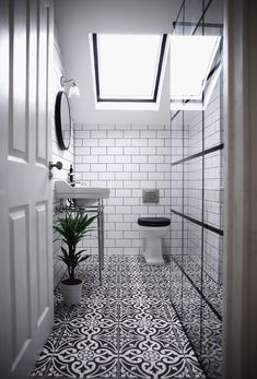 Victorian mid terrace Wetroom with black and white Devon stone geometric floral pattern tiles, subway metro tiled walls, Burlington shower, screen and sink with chrome legs Victorian Tiles Bathroom, Metro Tiles Bathroom, Marble Countertops Bathroom, Loft Bathroom, Upstairs Bathrooms, Bathroom Floor Tiles, Bathroom Interior, Bathroom Sconces, Family Bathroom