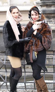 Two girls in fur have nice style. Prague.