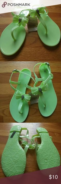 LIME GREEN JELLY THONG SANDALS SIZE 10 Super cute.  Great color!!  THONG Jellies topped with blinged out bows!  Sassy, sexy and adorable.  Brand new with tags. Dizzy Shoes Sandals