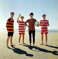 The Beatles on the beach 1964