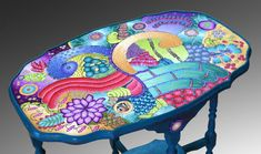 Alice Stroppel reclaimed a table by drawing a design and filling it with Premo clay. See here for directions: http://polymerclayetc.com