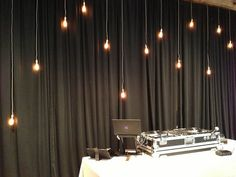 Hanging Edison Bulbs behind DJ at Camp Lucy by ILD Lighting
