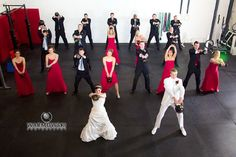 Between the wedding and reception, Monica and Luther wanted to stop by their CrossFit gym and have a photo taken of the bridal party doing a Kettlebell swing.