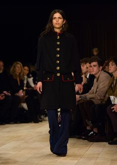 Black felted wool and cashmere military cape with wool and silk twill boot-cut trousers
