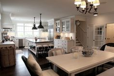 I like this kitchen. The Butlers Pantry, the island, the lighting, the table with camp chairs. scanard