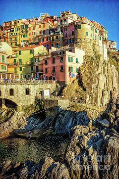 Check out this photograph by Joan Carroll! http://fineartamerica.com/featured/manarola-afternoon-cinque-terre-italy-joan-carroll.html via @joancarroll #5terre #cinqueterre #seaside @jo