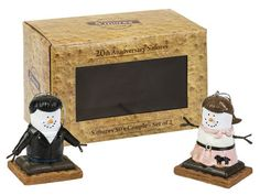 S'mores Original 20th Anniversary Limited Edition S'mores 1950's Couple set of 2 ornaments. She has a pony tail and poodle skirt, and he has a leather coat and blue jeans. Graham Cracker gift box with cello window for display. Item SM400016FC. Made Exclusively for Flying Cloud Gifts.
