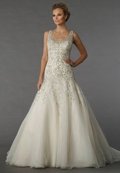Danielle Caprese for Kleinfeld 113071 - This a-line gown features a v-neck neckline with in chiffon and beaded embroidery. It has a chapel train and a tank top.