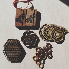 Taking stock of our #wood #lasercut #ornaments for the upcoming #holidayseason. We are also making #bronze #decorations this year! by biomorphics