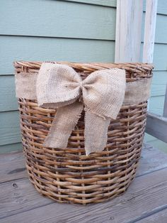 Huge wicker basket with burlap bow on Etsy. MinnesotaJunker