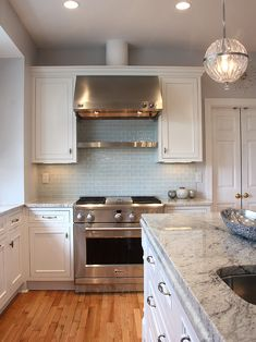 light blue subway tile backsplash - like it but not with these counters