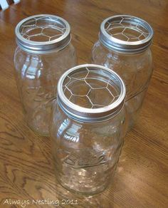 A good tip to keep flowers arranged in jars...using chicken wire under the lids