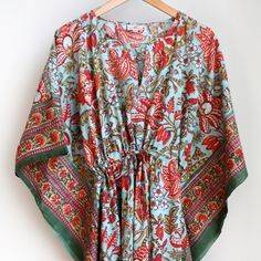 Light weight cotton full length kaftan made by Anokhi.  Draw string waist.  Hand block printed in Jaipur, India.    Colours: Teal blue, red and green.    100% Cotton. Machine washable.     One size.