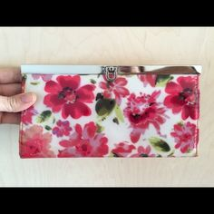 Pretty Floral Wallet Pretty wallet with red and pink flowers.  6 CC slots, cash slot, zippered compartment and open compartment.  8x4. Bags Wallets