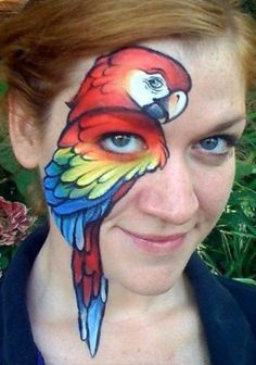 Rosella or parrot face painting.  Beautiful face painting work!