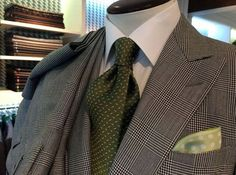 A Prince of Wales check fabric is set off with a white shirt & some sharp olive silk accessories