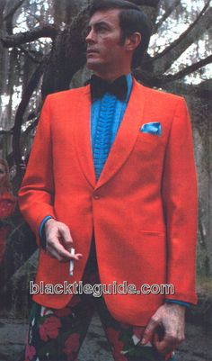 Mod Red Dinner Jacket, Contrasting Electric Blue Shirt with Large Bow Tie and Tight Floral Dress Pant