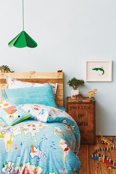 We love this idea of incorporating your kid's favorite animals into their room with artwork, bedding and more!