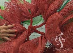 Poinsettia wreath tutorial - pulling twists together in the center, filing the center with a place to attach stemballs