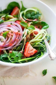 Vegan Spiralized Cucumber Salad with Chia Strawberry Vinaigrette - This healthy cucumber salad recipe is mixed with fresh herbs, strawberries and a homemade lime-strawberry vinaigrette. It's a fresh, paleo & vegan meal for only 230 calories! Healthy Salad Recipes, Raw Food Recipes, Vegetarian Recipes, Cooking Recipes, Free Recipes, Strawberry Vinaigrette, Lime Vinaigrette, Strawberry Kiwi, Clean Eating