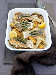 Salmon and Potato Al Forno- 'This is a brilliant one-tray dinner. Roasted fennel and potatoes are a magic combination, as are the fresh herbs and salmon. Scoring and stuffing the salmon is a great little trick you can use on any type of fish. Salmon Recipes, Fish Recipes, Seafood Recipes, Cooking Recipes, Healthy Recipes, Fennel Recipes, Healthy Meals, Recipies, Roasted Fennel