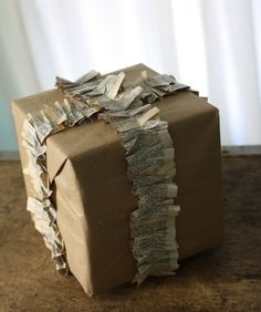 brown paper + newspaper + sewing machine = ruffle wrapped present