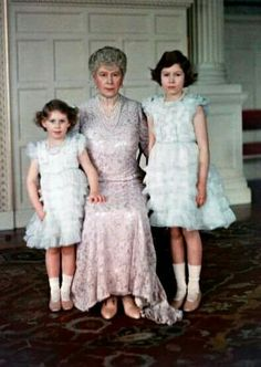 "Rare colour (although a bit blurry) photo of the Dowager Queen Mary and her granddaughters Princess Margaret (left) and Princess Elizabeth (right). This picture was taken at Sandringham House in late January 1936 shortly after King George V died and the start of the brief reign of the girl's infamous uncle Edward VIII. The sad look on the future Queen's face is pretty understandable since she has recently lost her beloved ""Grandpa England""."