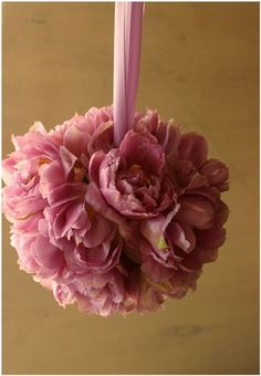 Pink peony bridesmaid pomander #springwedding #bridesmaid - Beautiful Spring colours bring this stunning bouquet to our attention, simplistic styling with just a hint of yellow nestled in the bloom of pink petals. We love it!