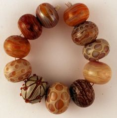 Blown hollow glass beads by Jari Sheese.