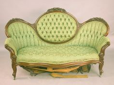 VICTORIAN MEDALLION-BACK (or mirror-back) SOFA, Rococo Revival, Louis XV sub style, American, c. 1855-1870, having a carved and molded walnut frame with later upholstery.