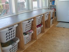 Dream laundry room - like the baskets and the folding counter Garage Laundry, Laundry In Bathroom, Laundry Closet, Laundry Tips, Laundry Basket Storage, Storage Baskets, Toy Storage, Storage Ideas, Storage Spaces