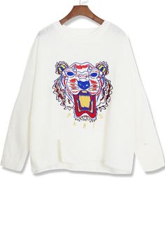 The #sweater featuring tiger embroidered. Round neck. Long sleeve. Side slit. Loose-fitting.