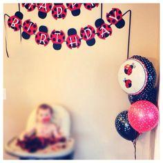 Ladybug birthday banner and balloons