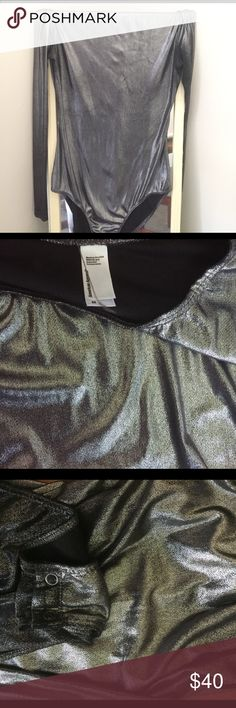Long sleeve metallic body suit Long sleeve silver metallic body suit , really stretchy and comfortable  , worn once , button closure on bottom and scoop neckline American Apparel Other